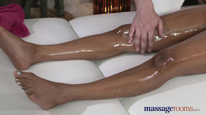 Ebony MILF with oiled body pleased by handy dude