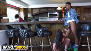Interracial couple is having sex on a barstool