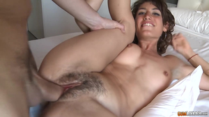 Angelic brunette spreads legs on the bed
